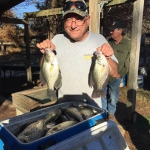 Paul Fisher and wife limiting out on Crappie!